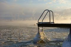 Swimming jetty and buoy in the freezing Baltic Sea in Helsinki, Finland Stock Photos