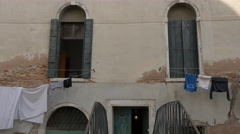 Old building with two large windows and clothes line in Venice - stock footage