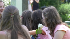 Girl with a rose and her friends sitting in a park, Cluj-Napoca Stock Footage