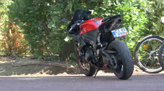 Motorcycle parked on an alley in Iuluis Park in Cluj-Napoca Stock Footage