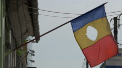 Romanian flag waving on a building in Cluj-Napoca Stock Footage
