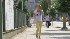 Adults and children walking by Gothaer insurance agency in Cluj-Napoca Stock Footage