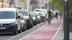 Riding bikes on Heroes Boulevard, Cluj-Napoca Stock Footage