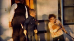 1951: Boy in coonskin cap toy guns fighting with schoolmate. LINCOLN, NEBRASKA Stock Footage
