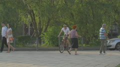 Riding bikes near Cluj Arena in Cluj-Napoca Stock Footage