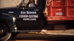 Stock Video Footage of 1951: Ray Thurman custom cutting truck coop feed signage. KIOWA, KANSAS