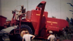 1951: Red Cassey Harris farm tractor loaded and moved flatbed truck. LINCOLN, Stock Footage
