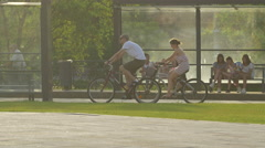 Two friends riding bikes in Cluj-Napoca Stock Footage