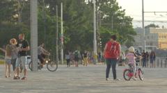 Little girl falling off a bike in Cluj-Napoca Stock Footage