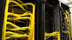 Modern Working Data Center Servers With Yellow Cable - Tilt Down Stock Footage