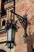 Old street lantern on the brick wall ,Chernivtsi,Ukraine - stock photo