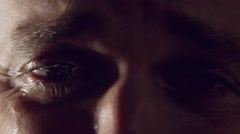 Crying man with tears in eyes, closeup with dramatic light Arkistovideo