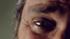 Crying man with tears in eye closeup Arkistovideo