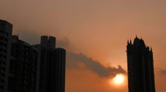 Sunset and silhouettes of buildings. Hong Kong. 4K resolution. Stock Footage
