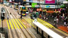 HONG KONG -  Double decker trams and people on crosswalk. Causeway bay. 4K Stock Footage