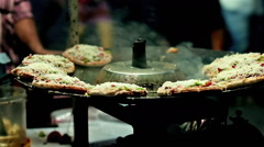 MUMBAI STREETFOOD: MINI PIZZAS [India, November 2015][CC/CG, Emulation] - stock footage