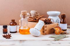 Bottle of essential oil with cinnamon stick ,star anise ,bay leaves with sele - stock photo