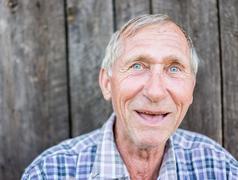 Happy smiling elder senior man portrait Stock Photos