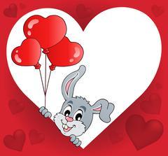 Heart shape with lurking bunny theme - eps10 vector illustration. Stock Illustration