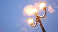 Vintage lampposts and falling snow Stock Footage