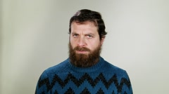 Hipster man saying no. Close up on neutral background - stock footage