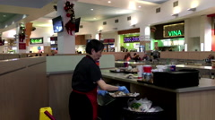 One side of worker cleaning garbage at food court area inside shopping mall Stock Footage