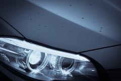 Car headlight detail - stock photo