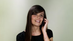 Lovely girl at phone. Close up studio on neutral background Stock Footage