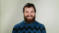 Hipster man saying yes! Close up on neutral background. Stock Footage