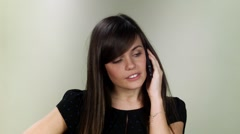 A girl is angry at phone. Close up in studio on neutral background Stock Footage