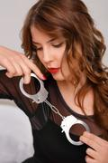 Sexual woman posing with handcuffs - stock photo