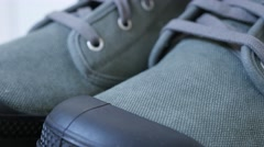 Modern man boots details close-up tilting on fabric and work  Stock Footage