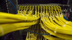 Data Center Servers With Yellow Cable Upload And Download Server  - Zoom Out - stock footage