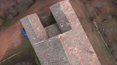 Red roof tiles on the old Abbey of Saint-Hilaire, Ollieres, France by drone Stock Footage