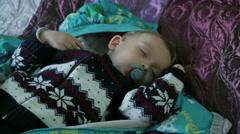 The cute sleeping boy - stock footage