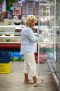 Senior woman shopping for dairy products Stock Photos