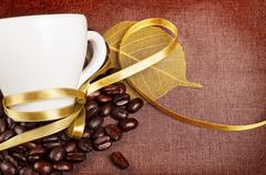 Coffee cup with yellow ribbon Stock Photos