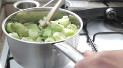 Cooking leeks in a pot Stock Footage