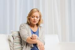 unhappy woman suffering from hand inch at home - stock photo
