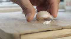 Crashing garlic cloves with chef knife Stock Footage