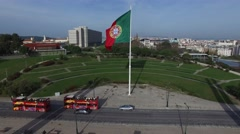 Portuguese Waving Flag on top of the Eduardo VII Park in Lisbon, Portugal Stock Footage