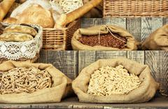 Pasta and pastries in bags on the wooden retro board Stock Photos