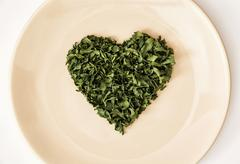 Heart shape of dried parsley on the plate, Valentine's day Stock Photos