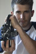Portrait of a man with a camcorder Stock Photos