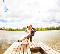 wedding couple  near water - stock photo
