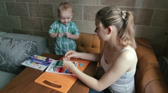 Mother and son playing with plasticine Stock Footage