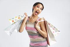 Studio Shot Of Funky Woman With Shopping Bags - stock photo