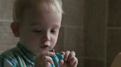 Little boy close up play with plasticine Stock Footage