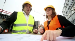 Architects on construction site - stock footage