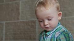 Little boy close up look around Stock Footage
